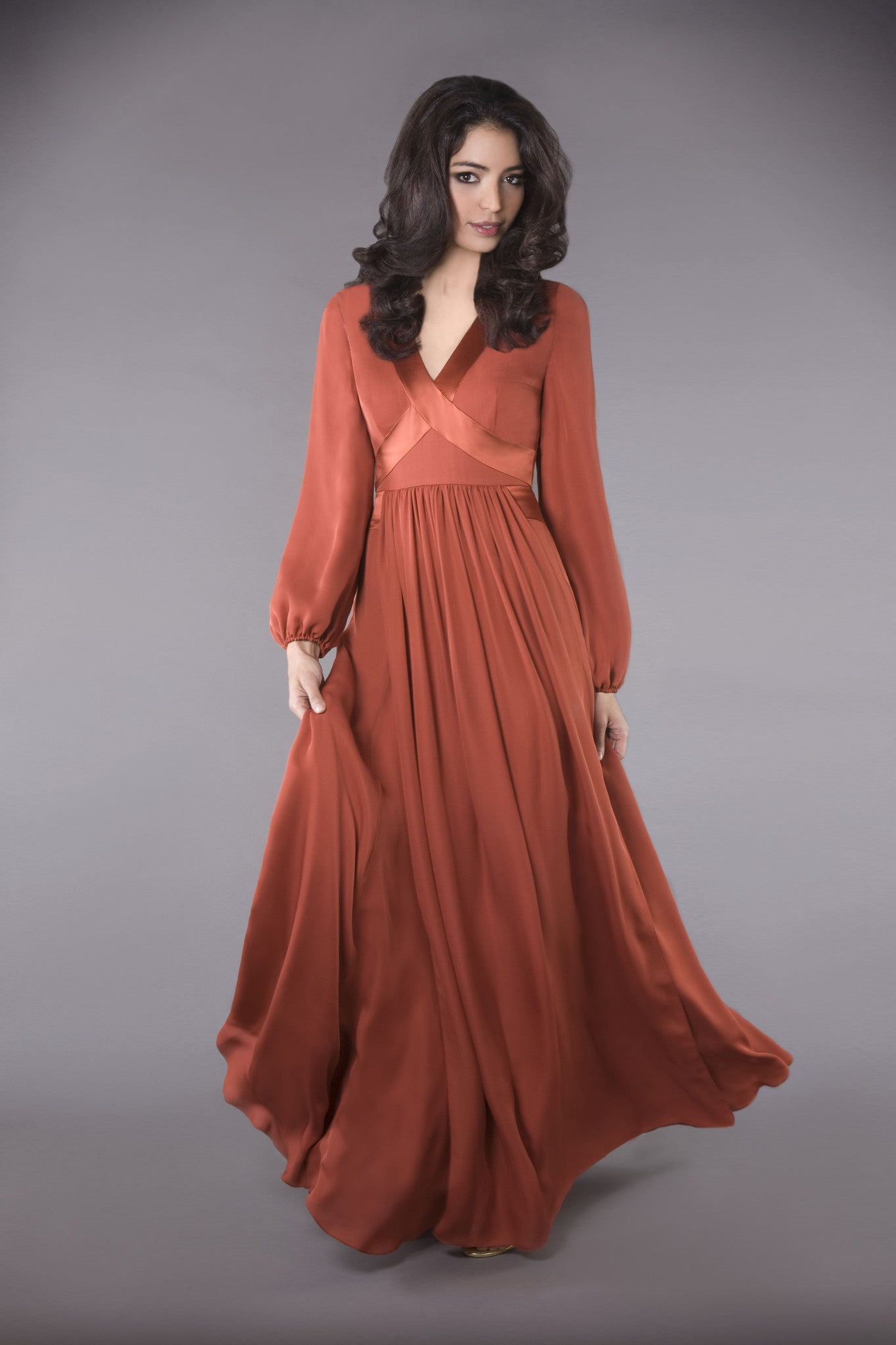 100% silk gown, long billowing sleeves, elegantly crisscrossed V-neckline, falls into a graceful hem sweep. Modest and classic