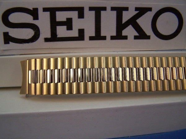 Seiko WatchBand Back Plate# 7N43-8A89 18mm gold tone Stretch Band w/Curved End