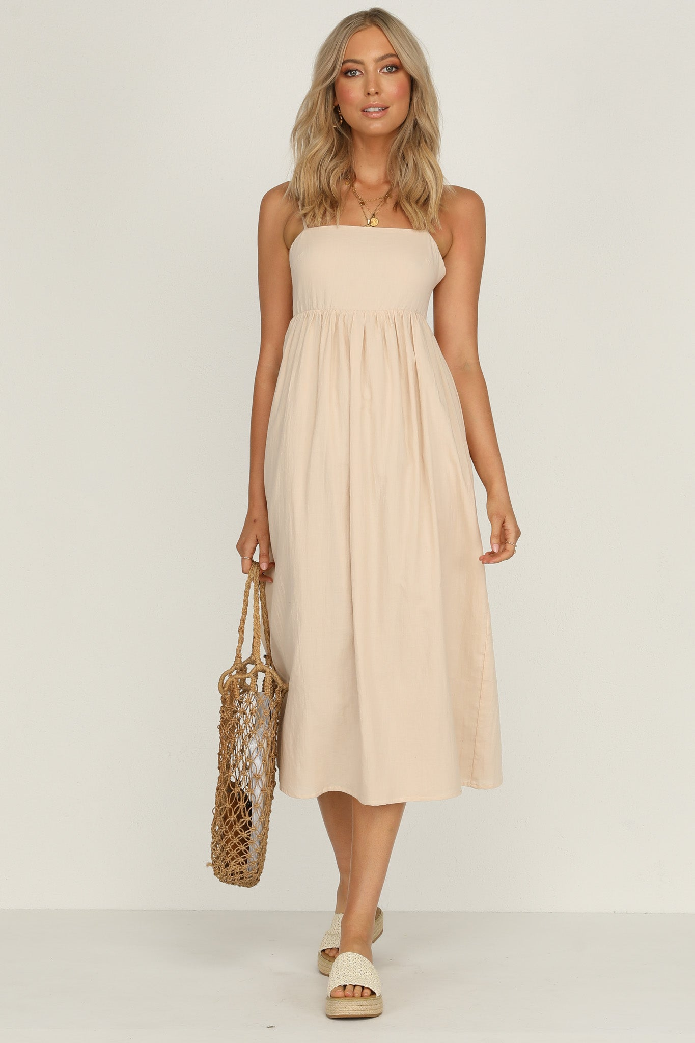 enchante dress in sand swing midi fit