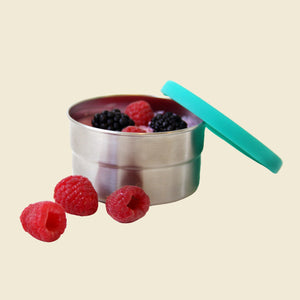 Stainless steel lunch box with red fruit and silicon lid