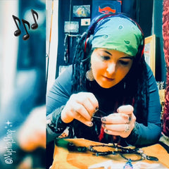 Marina making jewelry on her table