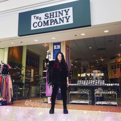 Marina in front of The Shiny Company, at Whote Oaks Mall, holding Mystiq jewelry