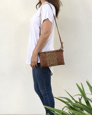 SPOTTED CALF HAIR CLUTCH- Cognac