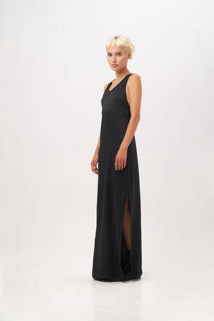 Alice is wearing the Annette K maxi Dress in black from Minuit Wear