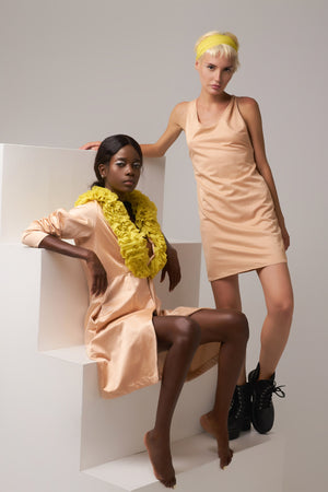 Tow models wearing Minuit Wear Creations. Irene is wearing the Oh My West Robe, while Alice is wearing the Annette K midi Dress