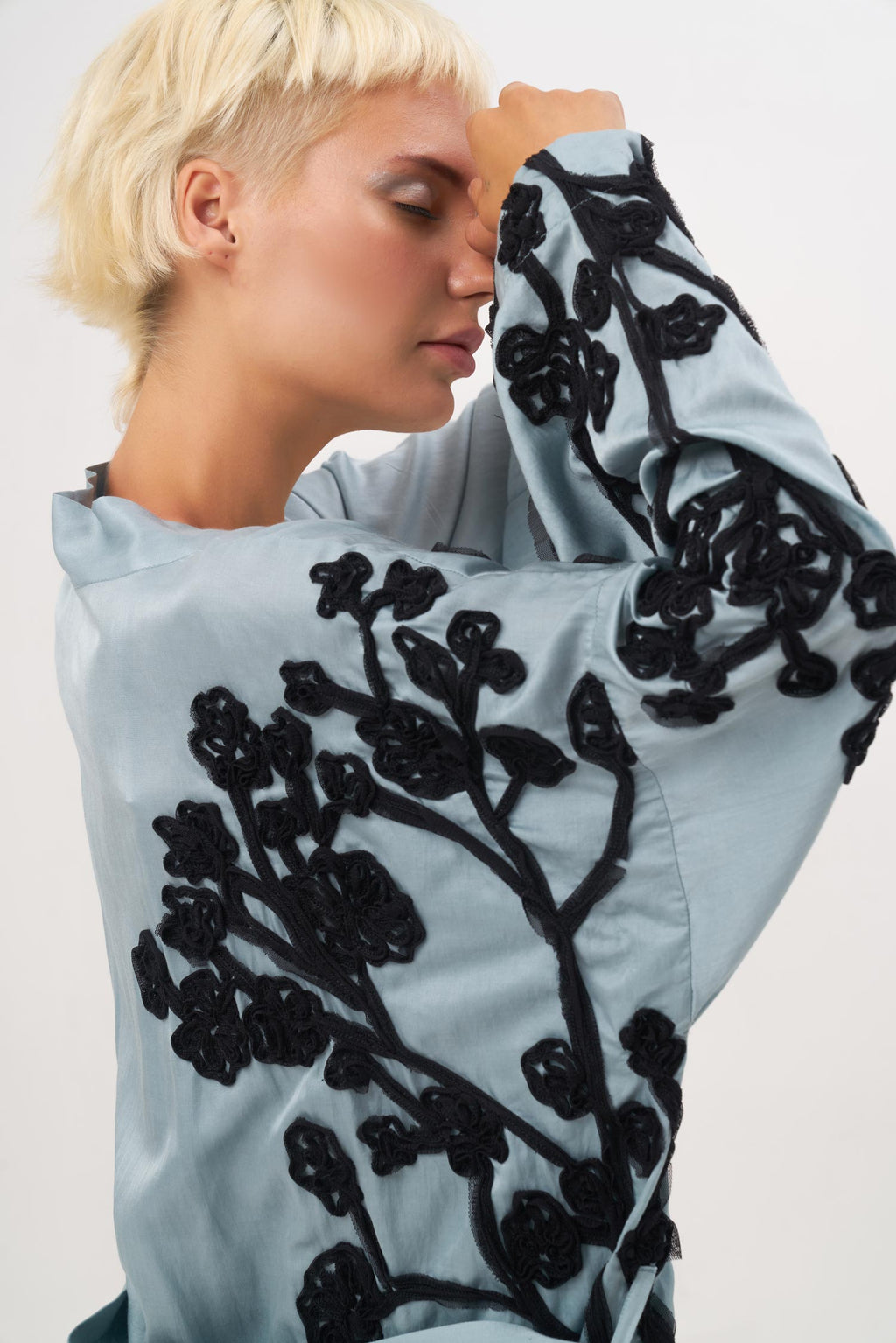 The Gypsophila Robe has a Kimono vibe with a more practical design.  The Asymmetrical embroidery of a maxi baby breath flower in a black soft tulle offers a beautiful contrast on the Silk Cotton blend.