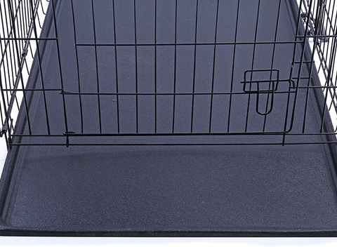 removable black tray in large dog kennel crate
