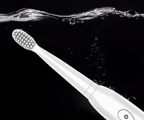 waterproof electric toothbrush white submerged in water