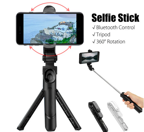 black selfie stick tripod with a smartphone attached and remote control