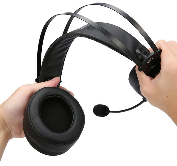 two hands pulling apart adjustable gaming headphones with mic