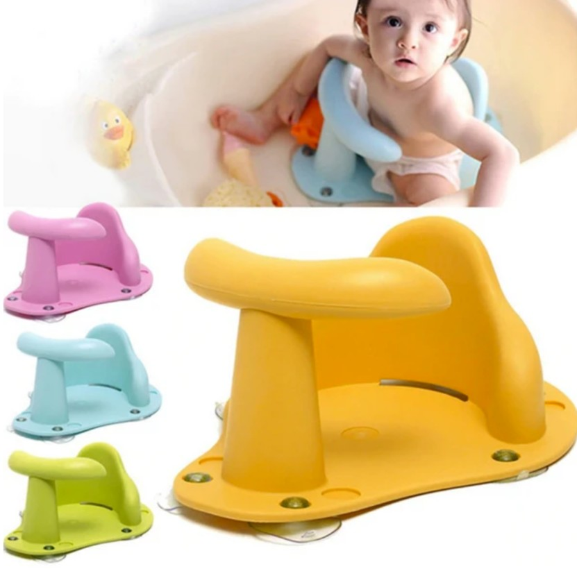 baby looking up in the tub in an infant bath seat yellow green pink blue