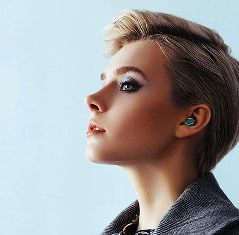 young blond woman listening to music with earbuds in her ears