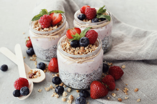 Chia seed pudding in glass with strawberry topping
