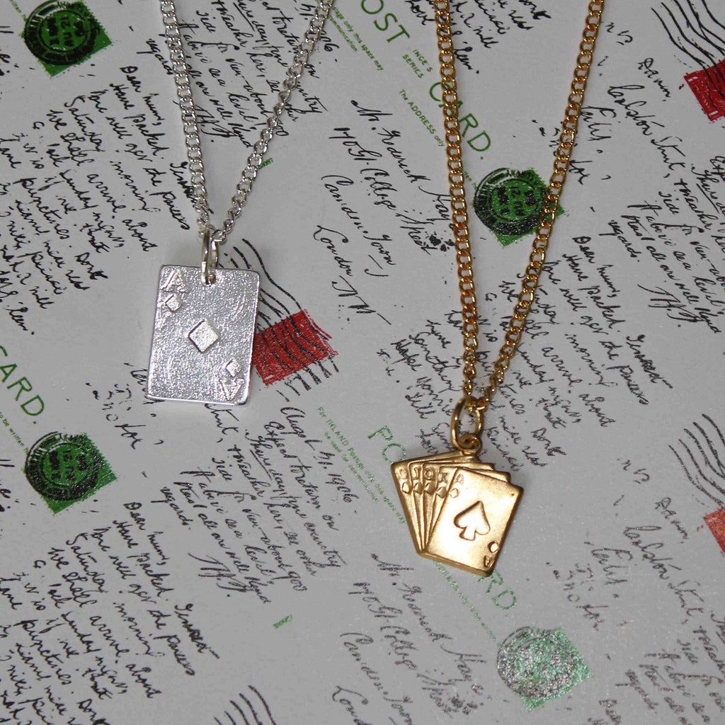 silver and brass tone ace of cards necklaces