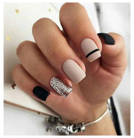 short nails in nude base and black nail art designs