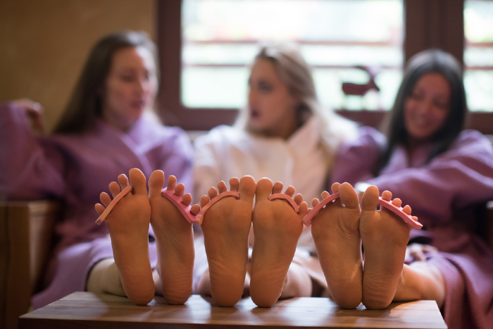spa pedicure session of girls enjoying their bridal party