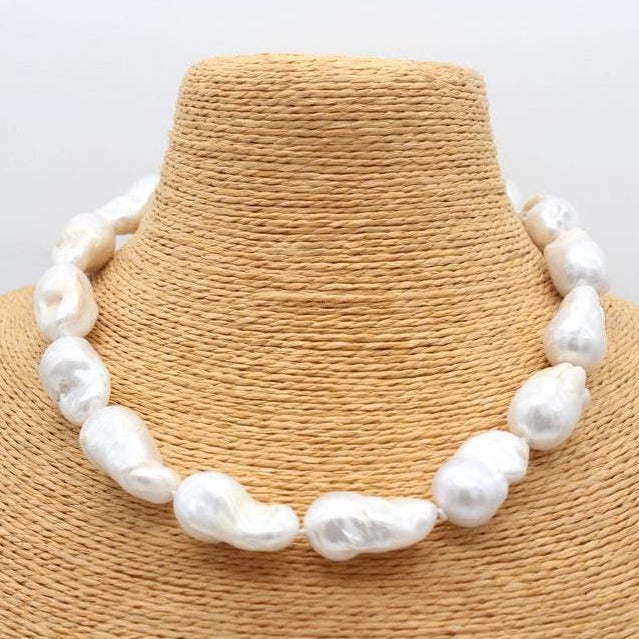 60s Mod Clothing Outfit Ideas BIG Baroque Freshwater Pearl Necklace White Pearl 15-25mm Super Pearls $188.00 AT vintagedancer.com