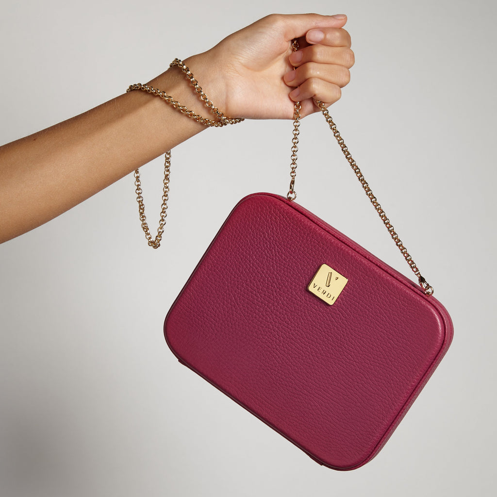 Atelier Verdi Luigia clutch bags stacked on top of each other