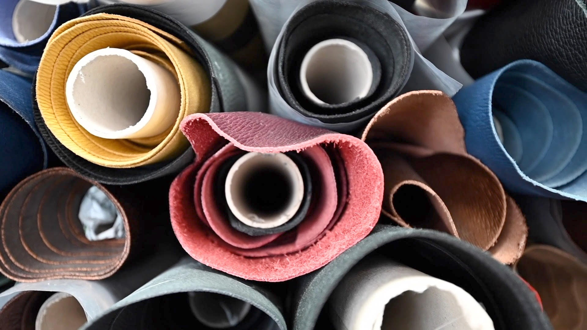 Atelier Verdi rolls of multi-coloured leather at the tannery