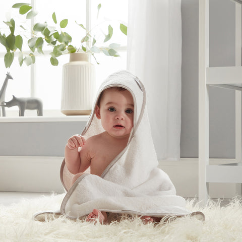 baby in wearable hooded white towel