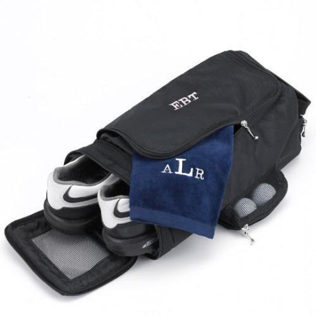 Black golf shoe bag with a dark blue towel hanging out with the initials ALR