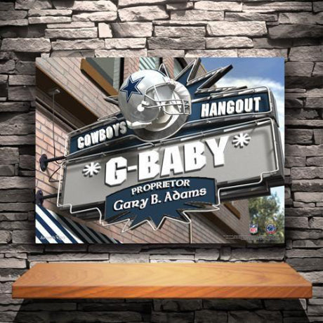 Bar sign on a canvas print that says Cowboys Hangout G-Baby Proprietor Gary B Adams