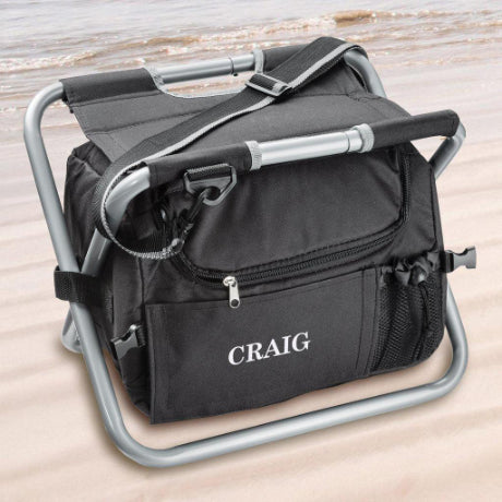 Black personalized cooler chair with the name Craig stitched into the side