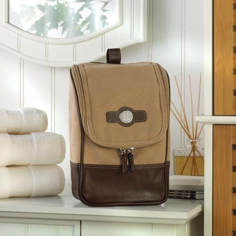 A brown travel bag in several shades of brown with personalized initials on the front