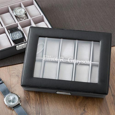 A black leather watch box that says Elliot R Grayson on the cover