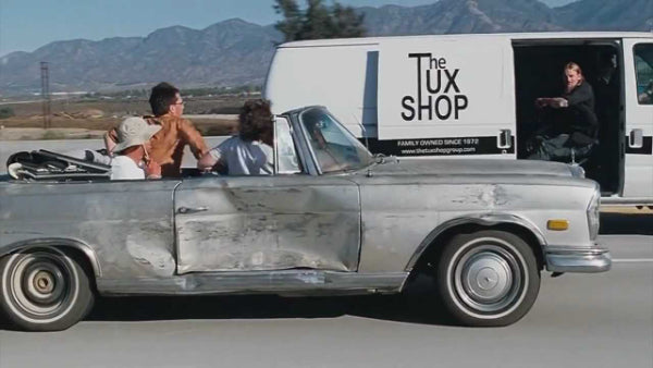 The Tux Shop delivering a tux while driving in the movie The Hangover