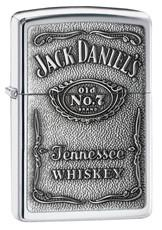 A silver zippo lighter with Jack Daniel's Whiskey branding engraved on the font