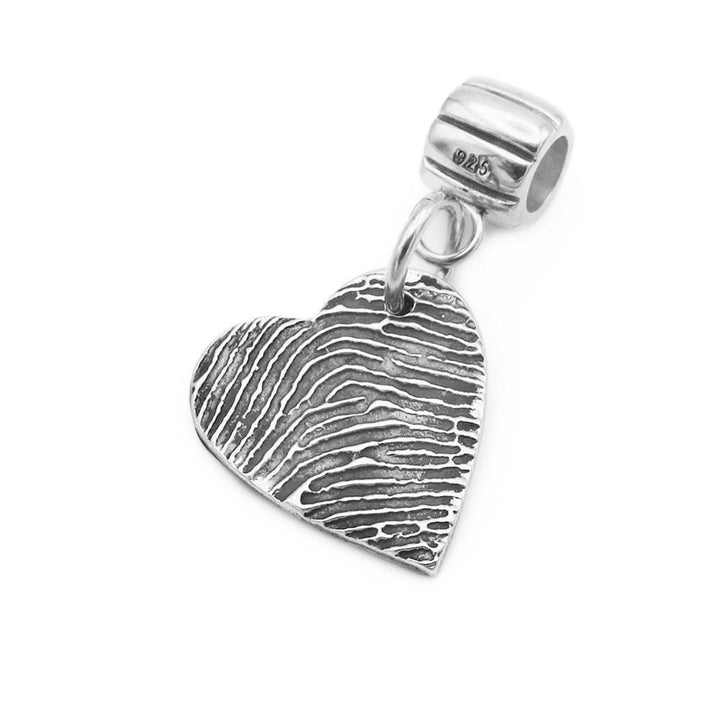 Heart shaped fingerprint charm on silver carrier