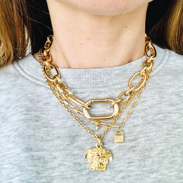 Carabiner Chunky Gold Chain Necklace on a model styled with other necklaces