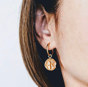 Close up of model wearing Bee Gold Coin Hoop Earrings.