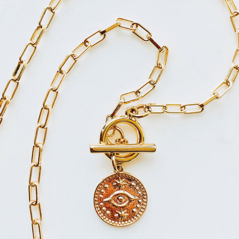 Close up of Evil Eye Coin Pendant Toggle Chain Necklace