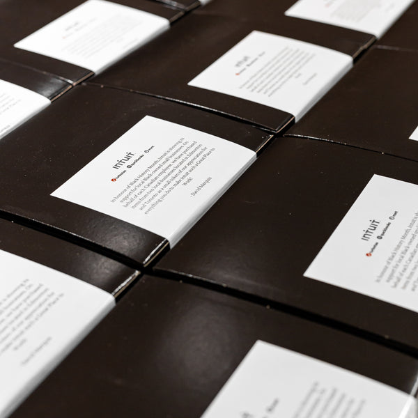 black gift boxes with message from Intuit Canada country manager, David Marquis