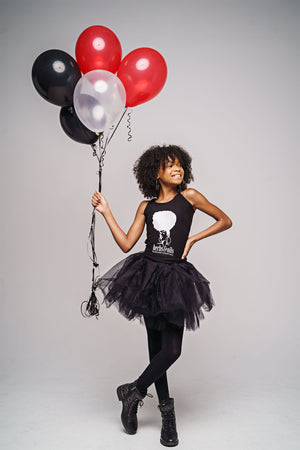 Little Girl with naturally curly hair styled with Herbs and Oils Hair Tonic.  Wearing an Herbs & Oils tank with balloons