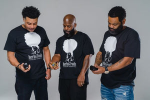 3 men with Herbs & Oils T-shirts holding Herbs and Oils Hair Tonic, 2 men with Beards that use Herbs and Oils for beard maintenance