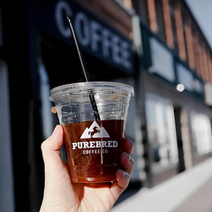 iced coffee beverage in front of purebred coffee