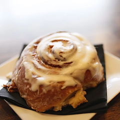closeup of a cinnamon roll on a dish