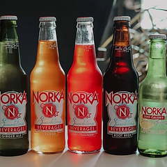 a row of multi-flavored Norka Soda bottles