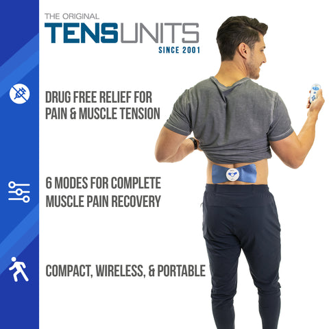 full body image of man with wireless pain therapy massage unit on lower back while holding controller