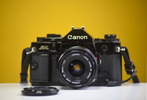 Canon AE-1 Program Black 35mm Film Camera with Canon FD 50mm f/1.8 Lens and Data Back