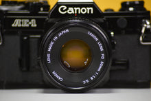 Load image into Gallery viewer, Canon AE-1 Black Vintage 35 Film Camera With 50mm F/1.8 Prime Lens