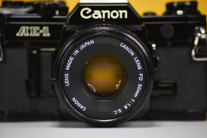 Canon AE-1 Black Vintage 35 Film Camera With 50mm F/1.8 Prime Lens