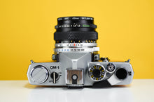 Load image into Gallery viewer, Olympus OM1 MD 35mm Film Camera with Zuiko 50mm f/1.8 Prime Lens