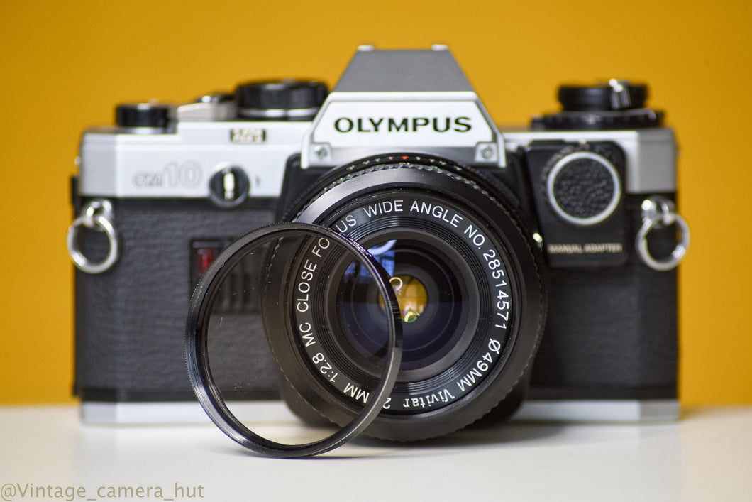 Olympus OM10 Vintage Slr 35 mm Camera film with Vivitar 28mm 1:2.8 Prime Lens and Manual Adaptor(rare)