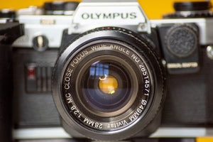 Olympus OM10 Vintage 35mm Film Camera with Vivitar 28mm f/2.8 Prime Lens With Manual Adaptor and Auto Winder