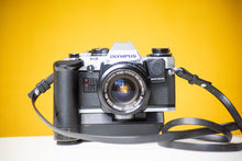 Load image into Gallery viewer, Olympus OM10 Vintage 35mm Film Camera with Vivitar 28mm f/2.8 Prime Lens With Manual Adaptor and Auto Winder