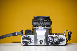 Olympus Om10 Slr Vintage 35mm Film Camera with Zuiko 50mm f1.8 Prime Lens, Lens Filter, Strap and Olympus Manual Adapter